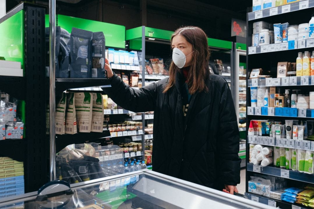 Image of woman in shop wearing a mask