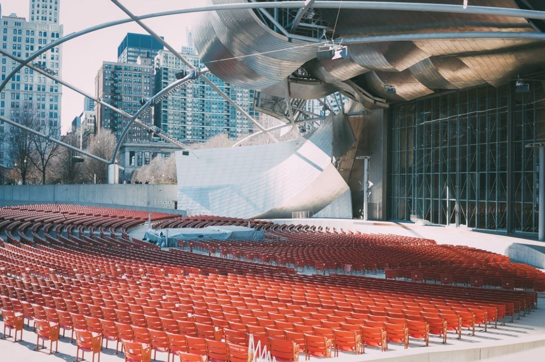 Image of empty stage and seating areas at venue