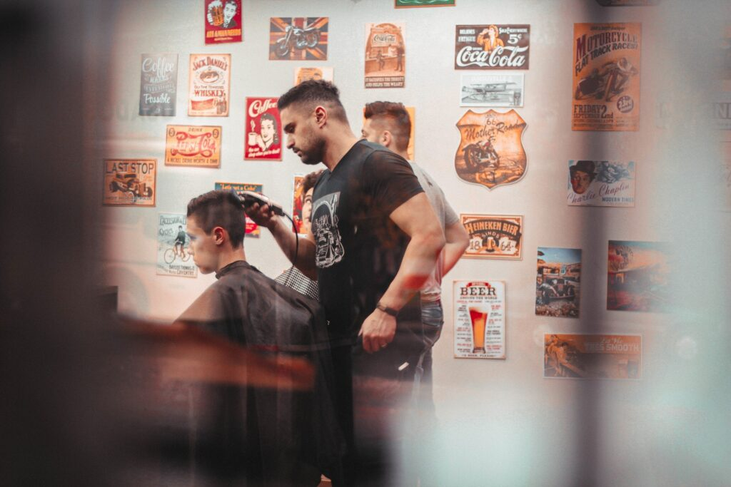 Image of a barber cutting hair.